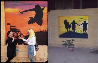 متطوعون يزينون سور مركز أورام المنصورة قبل افتتاح التجديدات   صور