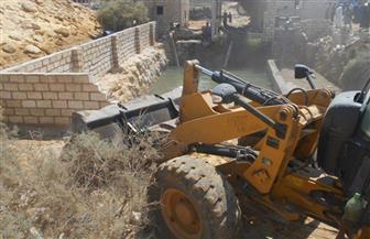 """ضبط ماكينات مياه مخالفة وإزالة تعديات على """"بحر الجرجبة"""" بالفيوم"""