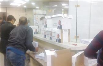 الهيئة الوطنية للانتخابات تفحص توكيلات وأوراق ترشح السيسي للرئاسة | صور