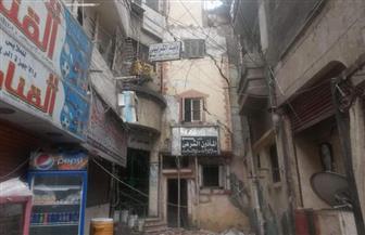 انهيار عقار بشارع بنك مصر في المنصورة | صور