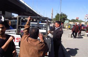 حي الوايلي يرفع إشغالات ميداني العباسية وعبده باشا| صور