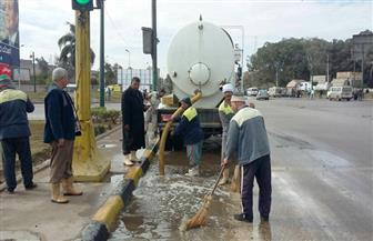 طوارئ بالجيزة لشفط مياه الأمطار الدفع بـ 25 سيارة لإزالة أثار المياه | صور