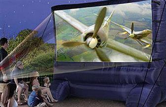 """""""سينما محمولة""""..اختراع أمريكي جديد يتيح المشاهدة لعشاق الأفلام!"""