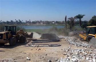 إزالة 27 حالة تعد على نهر النيل وأملاك الرى بطهطا | صور