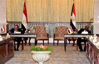 الرئيسان السيسي والبشير يوقعان محضر الاتفاقيات بين مصر والسودان