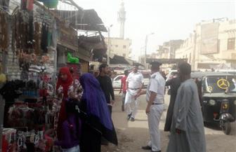 حملة لإزالة الإشغالات بإسنا وتحرير 23 محضرا| صور