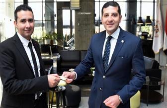 تسليم أول بطاقة ضريبية بهيئة الاستثمار وفقا للإجراءات الجديدة