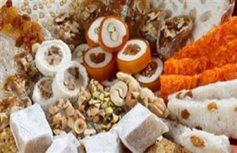 """""""الحلويين"""" أول سوق لصناعة """"حلاوة المولد"""" في عهد الفاطميين"""