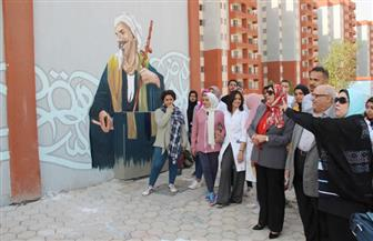 جامعة عين شمس تشارك في تجميل حي الأسمرات |صور