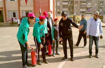 بيان عملي لعملية إخلاء مدرسة فى بورسعيد أثناء وقوع حريق وهمي | صور