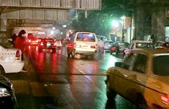 كثافات مرورية بشوارع القاهرة والجيزة بسبب الأمطار | صور