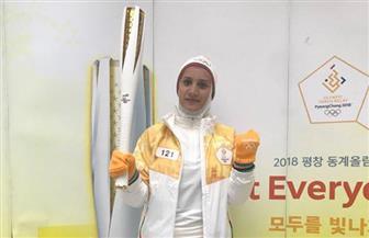 آية مدني تحمل شعلة دورة الألعاب الأوليمبية الشتوية في كوريا الجنوبية