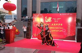 إنارة برج القاهرة باللون الأحمر احتفالا بعيد الربيع الصيني
