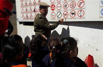 محاضرة لطلاب المدارس بأسيوط للتوعية بقواعد وآداب المرور| صور
