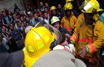 انتشال طفل من تحت أنقاض عقار منشأة ناصر المنهار   صور