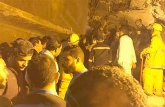 إنقاذ سيدة من تحت أنقاض عقار منشأة ناصر   صور