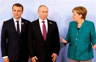 ماكرون وميركل يبحثان مع بوتين تطبيق الهدنة في سوريا