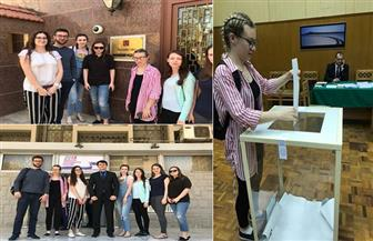 طلاب روس بجامعة أسيوط يدلون بأصواتهم في سفارة بلدهم بالانتخابات الروسية| صور