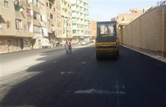 حي الهرم يواصل أعمال رصف وصيانة الطرق  صور