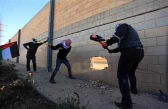 شبان يحدثون ثغرة بالجدار الفاصل في أبو ديس