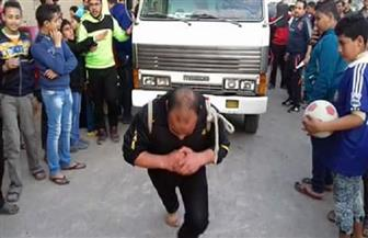 مسابقة لاختيار أقوى رجل في قرية الرطمة بدمياط| صور وفيديو