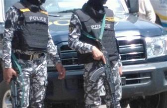 سيارات حماية المواطنين والشرطة تجوب شارع الهرم لتأمين الانتخابات | صور