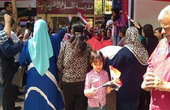 أغانٍ وطنية تتصدر مسيرة لأهالي بحدائق القبة | صور