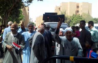 مسيرة لعائلات الكرنك للتصويت في الانتخابات بالأقصر | صور