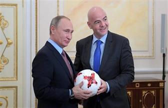 بوتين وإنفانتينو يستعرضان مهاراتهما الكروية قبل كأس العالم