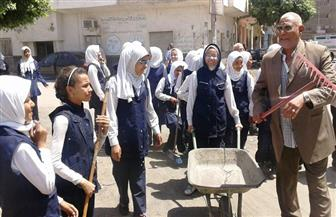 طلاب المدارس يشاركون في حملة تنظيف وتجميل بأسوان   صور