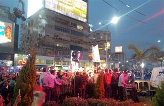 مواطنون يحتفلون بفوز الرئيس السيسي بفترة ثانية في ميدان روكسي | صور