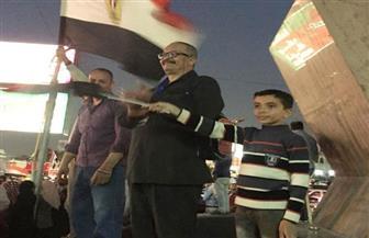 المصريون يحتفلون بفوز السيسي بفترة ثانية بميدان الشهيد هشام بركات | صور