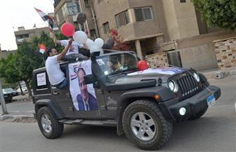 المصريين الأحرار يجوب ميادين مصر الجديدة احتفالا بفوز الرئيس السيسي | صور