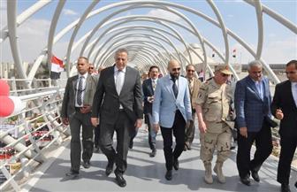 محافظ الجيزة يفتتح كوبري مشاة جامعة مصر للعلوم والتكنولوجيا بأكتوبر| صور