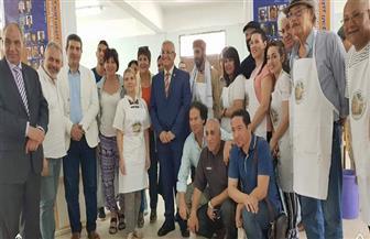 محافظ المنيا ورئيس الجامعة يفتتحان معرض ملتقى دير جبل الطير الدولي | صور