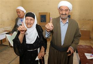 منافسة قوية بين العبادى والعامرى والمالكى ..العراقيون يتوافدون للمشاركة فى الانتخابات العامة | صور