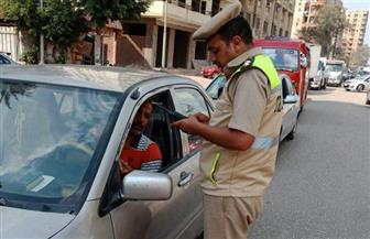 استمرار حملات التوعية المرورية علي الطرق وإدارات المرور| صور