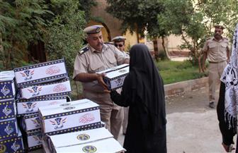 مديرية أمن أسوان توزع وجبات إفطار على المواطنين | صور