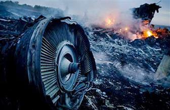 """""""محققون"""": صاروخ أطلقه الجيش الروسي وراء إسقاط الطائرة الماليزية"""