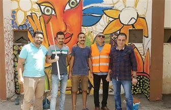 مبادرة شبابية لرفع العبارات المسيئة عن الجدران وعمل جدارية لسور جامعة عين شمس| صور