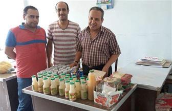 ضبط صاحب محل بقالة بحوزته 90 علبة عصير ومشروبات غازية منتهية الصلاحية بالفيوم| صورة