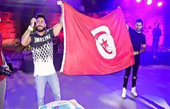 """تامر حسني: اليوم كلنا تونس.. شجع """"النسور"""""""
