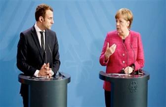 نهائي دوري أبطال أوروبا على طاولة مباحثات ماكرون وميركل