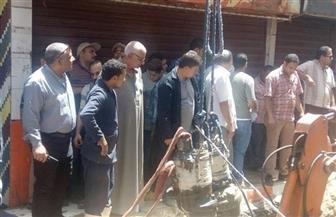 إصلاح كسر ماسورة مياه بشارع بور سعيد بالأميرية  صور