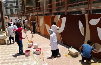 """تعاون بين """"المجتمعات العمرانية"""" و""""الفنون التطبيقية"""" لتنفيذ جداريات ضخمة بالشروق"""