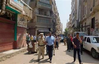 تحرير 55 مخالفة إشغالات وإزالة حواجز أسمنتية خلال يوم فى أسيوط | صور