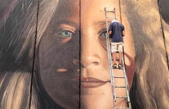 إسرائيل تعتقل إيطاليين رسما لوحة جدارية لعهد التميمي