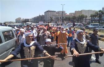 مسيرة لمتحدي الإعاقة على كورنيش الإسكندرية   صور