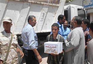 5 آلاف كرتونة سلع غذائية إضافية من القوات المسلحة لأهالي البلينا وأخميم | صور