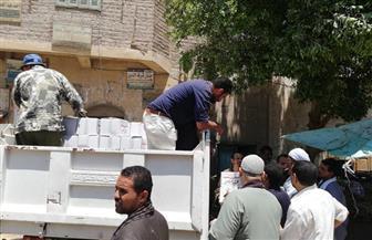 توزيع 38.6 ألف كرتونة مواد غذائية مدعمة من القوات المسلحة للأسر الأكثر احتياجا بأسيوط | صور